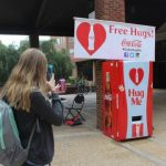 Coke sought to 'spread some happiness' in Athens with Hug Machine