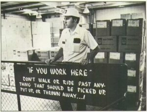 man in a hard hat working in coca cola factory